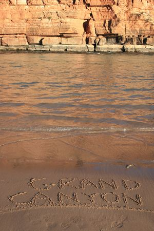 vertical image of Colorado River with Grand Canyon written in the sand Stock Photo - 3864018