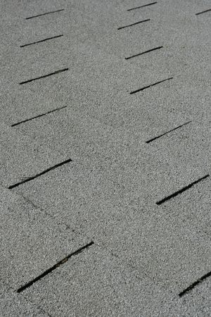 Diagonal detail of gray roof shingles photo