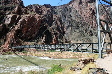 silver foot bridge across the Colorado River at the bottom of the Grand Canyon, Arizona Stock Photo - 3864030