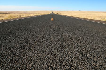 closeup of the pavement of empty straight highway 180 in Northern Arizona