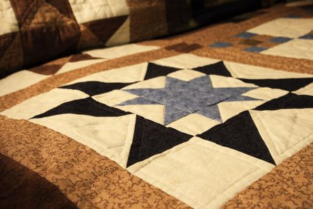 homemade quilt on a sofa with shallow depth of field Banco de Imagens