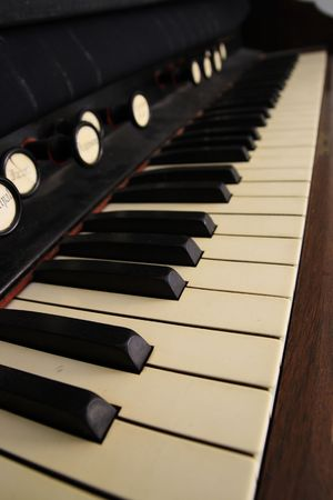 vertical image of an antique pedal organ keyboard with shallow depth of field Stock Photo - 3864044