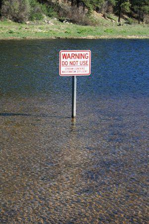 effluent: warning sign on water for wastewater effluent