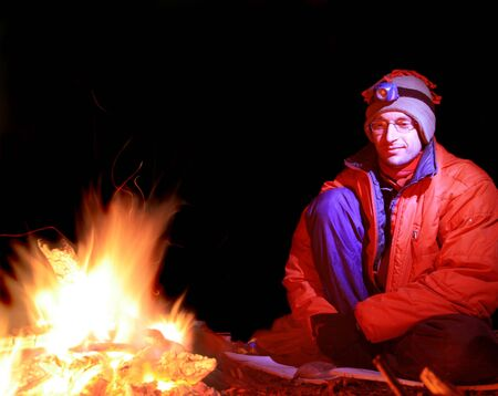 long exposure of a man in cold weather clothing sitting by a campfire Stock Photo - 3911910