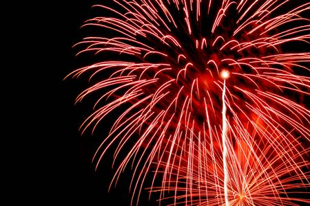 long exposure of multiple orange and red fireworks against a black sky Stock Photo - 3935768