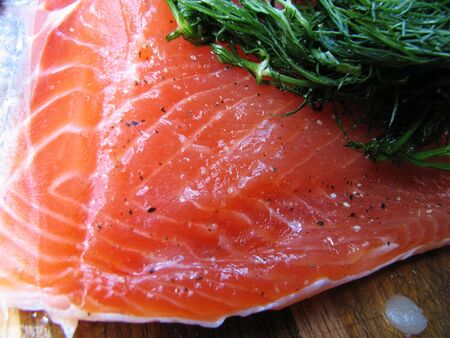 gravlox or gravlax salt cured salmon with dill Stock Photo