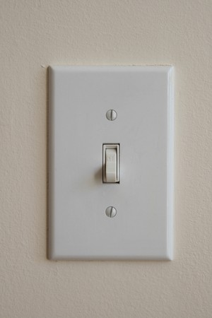 wall light switch flipped down to the off position