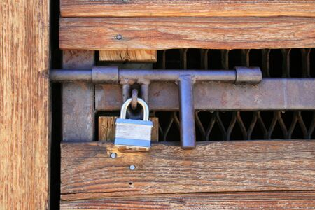hasp: padlocked wood and metal door with heavy duty hasp