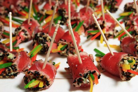 a plate of rolled tuna sushi held on toothpicks Stock Photo - 4015361