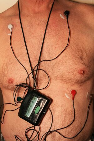 torso of old man wearing a 5 lead cardiac monitor harness Banco de Imagens