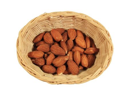 shelled: small wicker basket of shelled almond nuts isolated on white Stock Photo