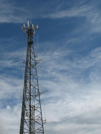 eyesore: Cell phone tower against a partly cloudy sky with copy space