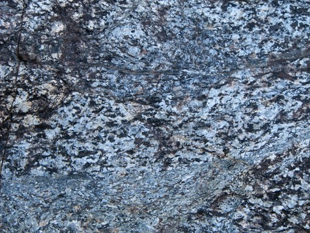 weathered gray granitic gneiss rock surface with cracks Stock Photo - 4152788