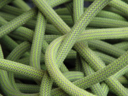 yellow and green used climbing rope in a pile Фото со стока