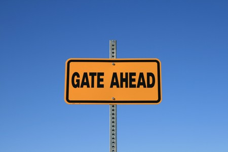 gate ahead road sign in yellow and black on blue sky background Stock Photo - 4271621