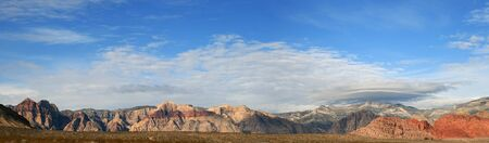 lenticular cloud: panorama of Red Rocks National Conservation Area with stormy weather approaching