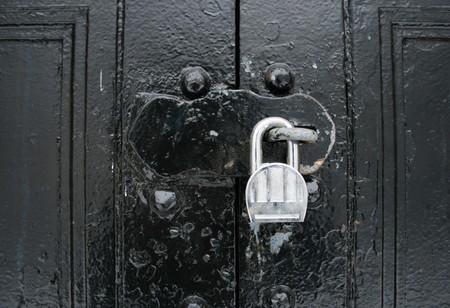hasp: padlocked hasp on black painted double doors