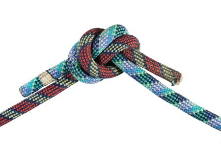 overhand: overhand knot in red and blue climbing ropes isolated on white