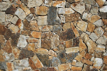 rockwall: orange, gray, brown, and tan stone wall background