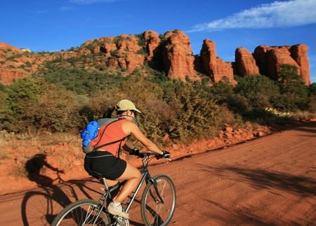 an Asian woman mountain biking along a dirt road near Sedona Arizona Stock Photo - 4443695