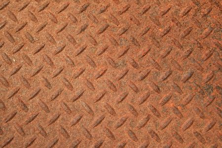 non skid: rusty textured steel panel with raised diamond pattern