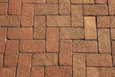 textured background of red bricks in a herringbone pattern from a walkway Stock Photo - 4764516