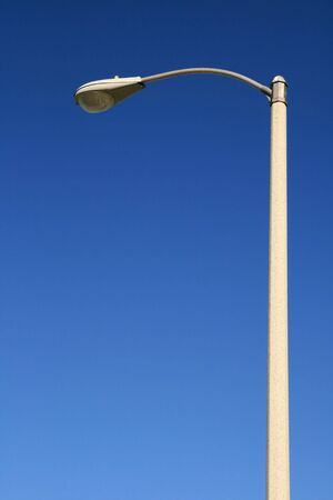 lampposts: street light against a blue sky background