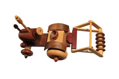 back top view of a wooden tractor with disk plow toy isolated on white Stok Fotoğraf