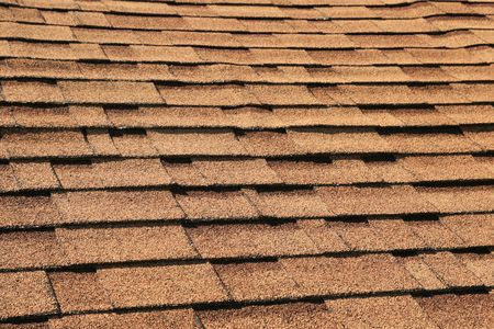 horizontal background of brown roof shingles