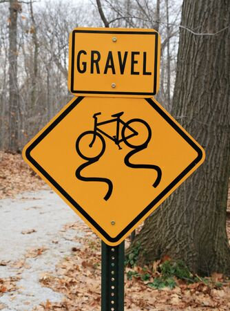 skidding: gravel warning sign for bicycle path showing skidding bicycle Stock Photo