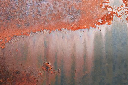rusting old painted metal tank grunge background photo