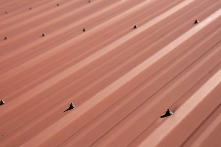 red sheet metal roof detail with selective focus Stock Photo - 5316825
