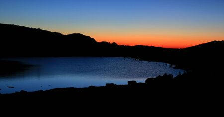 before sunrise the sky turns reddish over an alpine lake Stock Photo - 5347674