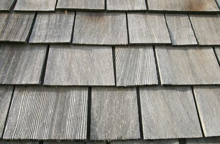 old gray wooden roof shingles on an old barn photo