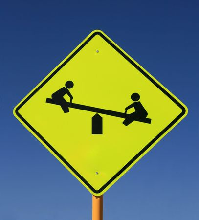 totter: playground road sign with see saw in yellow and black on blue sky background