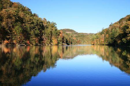 natural bridge state park: early fall reflection in Mill Creek Lake, Natural Bridge State Park, Kentucky with the leaves just starting to change color