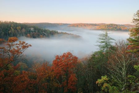 a fog filled valley in the autumn just after sunrise Stock Photo - 5863907