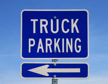 blue truck parking to the left sign with blue sky background Stock Photo - 5990615