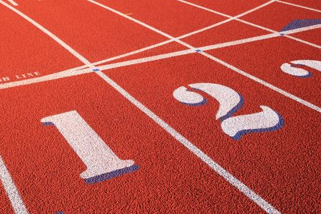 lanes one and two marked on a red rubber athletic track Stock Photo - 5990617