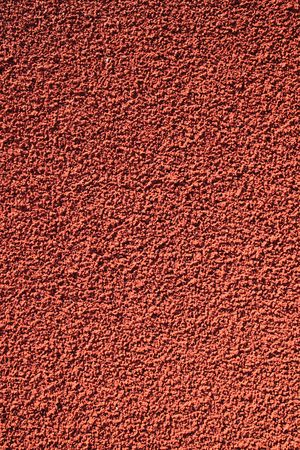 red crumb rubber running track close up background Stock fotó