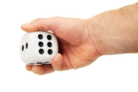 a mans hand rolling a giant white die isolated on white Stock fotó