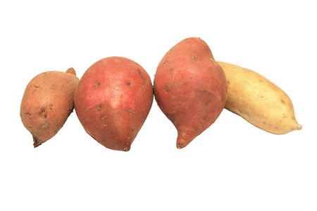 four sweet potatoes of different colors isolated on white Stock Photo