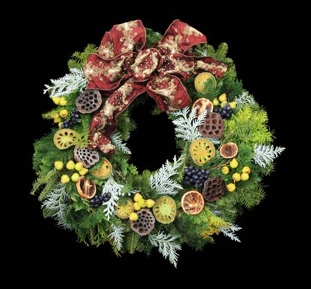 christmas wreath with mini pears and other decorations and a red bow isolated on black Stock Photo - 6080081