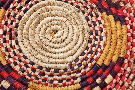 the center of the bottom of a colorful worn african basket Stock Photo - 6107539