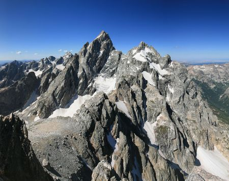 Grand Teton and Mount Owen from the summit of Teewinot peak photo