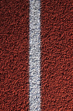 close up vertical image of white line on red rubber track Stock Photo - 6136052