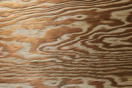 horizontal of old worn plywood background with grained texture