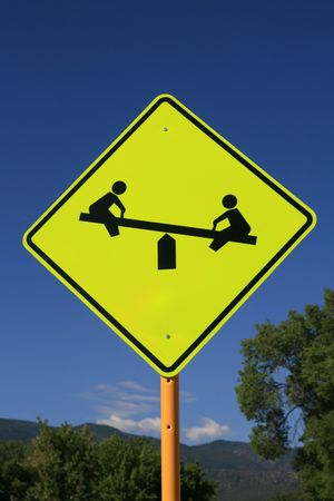 totter: playground road sign with seesaw in yellow and black