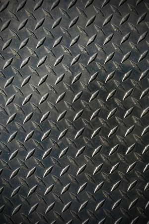 shiny metal background: diamond tread steel background texture with slight vignette