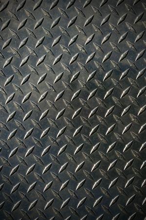 texture di sfondo in acciaio di battistrada di diamante con lieve vignetta